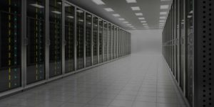 Picture of a server room with lots of servers stacked on top of each other.