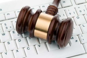 Gavel on top of a keyboard, representing IT computer services for legal offices