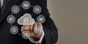 man touching icons that are floating in the air, difference icons representing different computer serivces